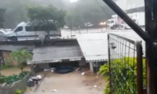 Flood waters were rising in their family home, but who was still trapped inside—stranger dives in