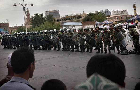 KASHGAR, CHINA - JULY 30:  Chinese soldiers in riot gear secure the area outside the Id Kah Mosque, after Imam Jumwe Tahir was killed by assailants following early morning prayers on July 30, 2014 in old Kashgar, Xinjiang Uyghur Autonomous Region, China. (Kevin Frayer/Getty Images)