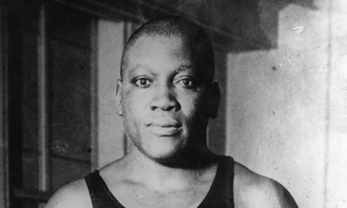 Jack Johnson (1878 - 1946) of the USA, one of the greatest heavyweight boxers of all time. In 1908 he took the world title from Tommy Burns and held on to it until Jess Willard beat him in 1915.   (Hulton Archive/Getty Images)