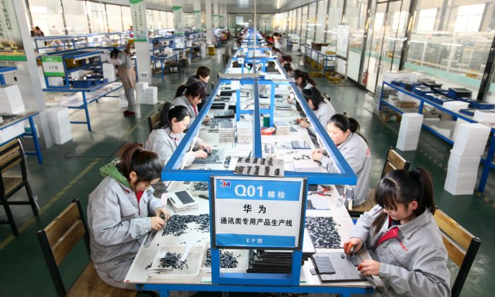 Workers at an electronics company in Tengzhou, in China's eastern Shandong Province, on Feb. 1, 2016. (STR/AFP/Getty Images)