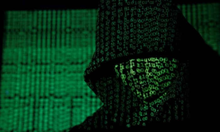 A projection of cyber code on a hooded man is pictured in this illustration picture taken on May 13,  2017. (Reuters/Kacper Pempel/Illustration)