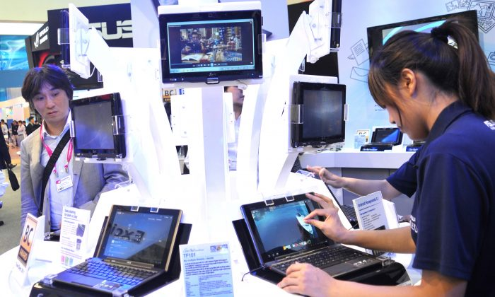 Exhibitors from U.S. tech giant Intel at a booth at Computex Taipei, Asia's biggest information technology and communications trade fair, on May 31, 2011. (Patrick Lin/AFP/Getty Images)