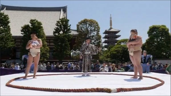 Sumo wrestlers face off with their babies