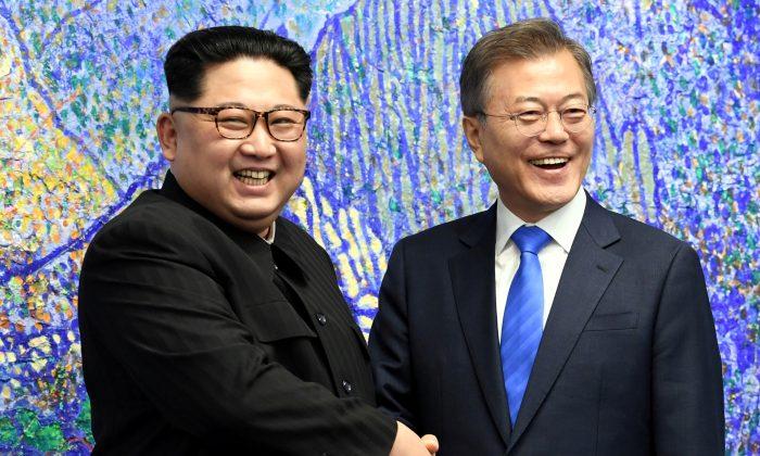 South Korean President Moon Jae-in shakes hands with North Korean leader Kim Jong Un during their meeting at the Peace House. (Korea Summit Press Pool/Pool via Reuters)