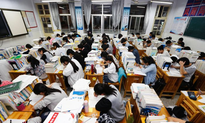 Senior high school students studying at night at a high school in Lianyungang, in east China's Jiangsu Province, on May 24, 2016. (STR/AFP/Getty Images)