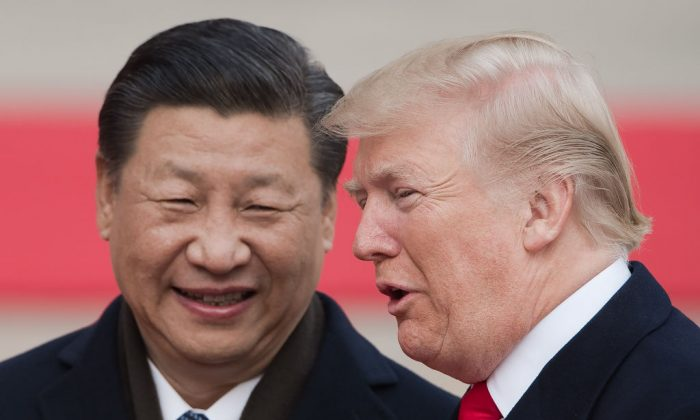 Chinese leader Xi Jinping (L) and US President Donald Trump attend a welcome ceremony at the Great Hall of the People in Beijing on Nov. 9. (Nicolas Asfouri/AFP/Getty Images)