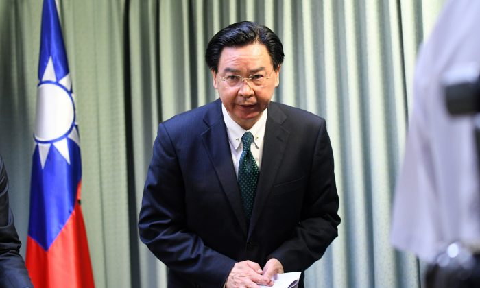 Taiwan Foreign Minister Joseph Wu arrives during a press conference in Taipei on May 1, 2018. - Taiwan said it was 'deeply upset' after the Dominican Republic, one of its few remaining official allies, established diplomatic relations with China and cut ties with the island. (Sam Yeh/AFP)