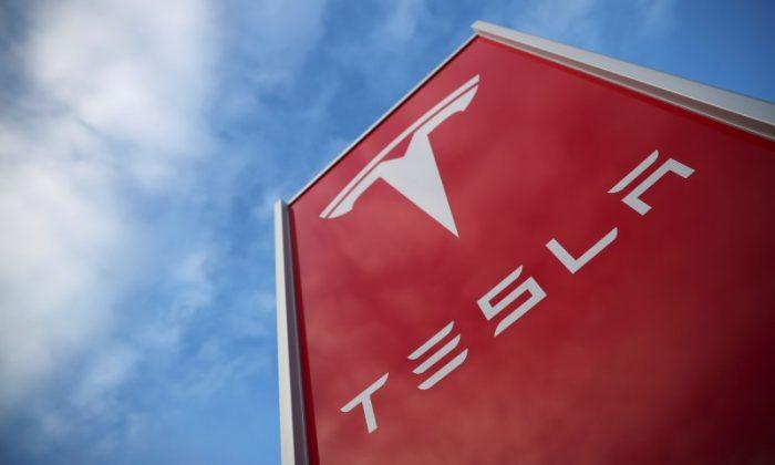 A Tesla dealership is seen in West Drayton, just outside London, Britain, Feb. 7, 2018. (Reuters/Hannah McKay)