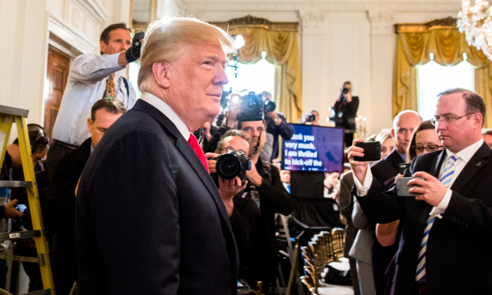 President Donald Trump arrives to deliver remarks at the Wounded Warrior Project Soldier Ride in the East Room of the White House on April 26, 2018. (Samira Bouaou/The Epoch Times)