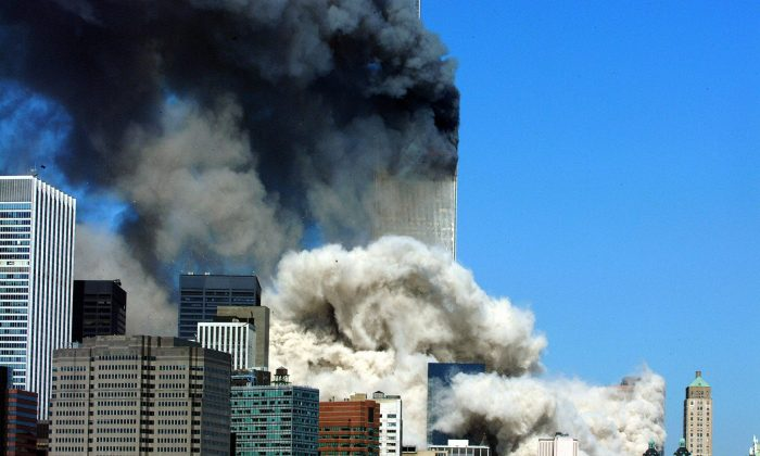 This 11 September, 2001 file photo shows smoke billowing up after the first of the two towers of the World Trade Center collapses in New York City. (HENNY RAY ABRAMS/AFP/Getty Images)