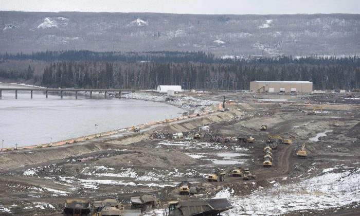 The Site C Dam location is seen along the Peace River in Fort St. John, B.C., on April 18, 2017. A partnership led by Aecon Group Inc. has been chosen as the preferred proponent by B.C. Hydro for a Site C generating station and spillways civil works contract. (The Canadian Press/Jonathan Hayward)
