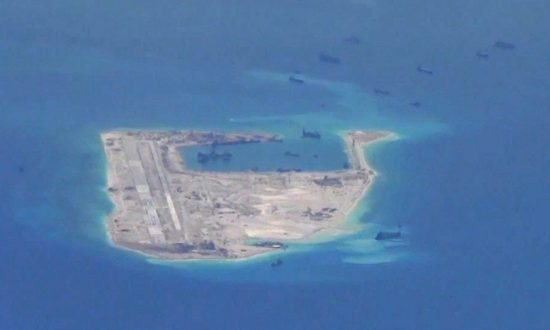 Chinese dredging vessels are purportedly seen in the waters around Fiery Cross Reef in the disputed Spratly Islands in the South China Sea, in this still image from video taken by a P-8A Poseidon surveillance aircraft provided by the United States Navy, on May 21, 2015. (U.S. Navy/Handout via Reuters/File Photo)