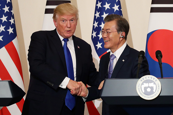 South Korean President Moon Jae-In (R) shakes hands with U.S. President Donald Trump (L) during the joint press conference at the presidential Blue House on November 7, 2017 in Seoul, South Korea. (Chung Sung-Jun/Getty Images)