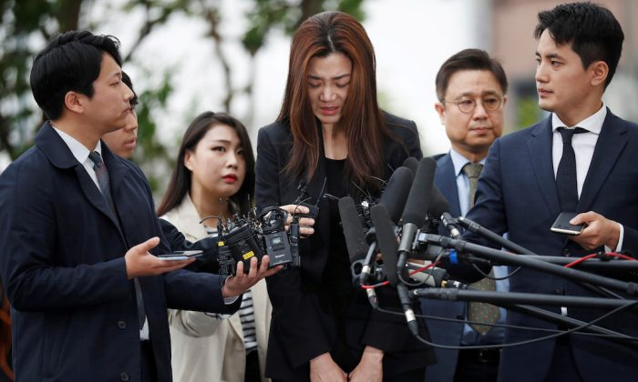 Cho Hyun-min, a former Korean Air senior executive and the younger daughter of the airline's chairman Cho Yang-ho, arrives at a police station in Seoul, South Korea. (REUTERS/Kim Hong-Ji)