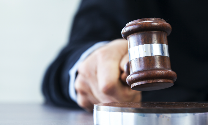 Immigration judges are swamped under a backlog created by a shortage of judges, inefficiencies, and paper filing. (Shutterstock)