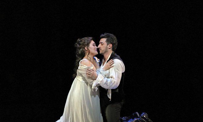 """Ailyn Pérez as Juliette and Charles Castronovo as Roméo in Gounod's """"Roméo et Juliette."""" Andrea Shin stepped in for Castronovo on the night the performance was reviewed. (Ken Howard / The Metropolitan Opera)"""