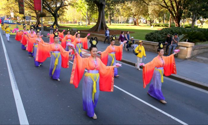 Sydney Falun Dafa practitioners participate in a World Falun Dafa Day parade in Sydney on May 5, 2018. Falun Dafa is a Buddha-school practice based on the universal principles of Truthfulness, Compassion and Forbearance. (Linda Zhang/The Epoch Times)