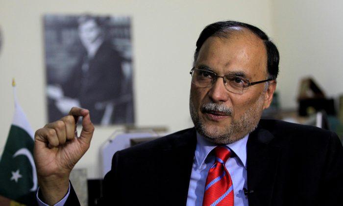 Pakistan's Interior Minister Ahsan Iqbal injured in gun attack in Punjab province
