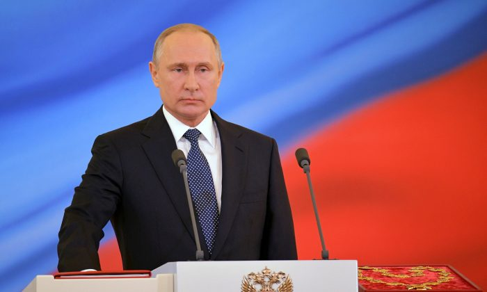 Russian President Vladimir Putin takes the oath during an inauguration ceremony at the Kremlin in Moscow, Russia May 7, 2018. Sputnik/Aleksey (Nikolskyi/Kremlin via Reuters)