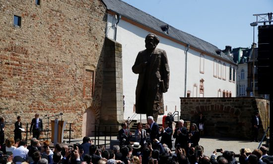 A bronze statue of Karl Marx donated by China to mark the 200th birth anniversary of the German philosopher, is seen in his hometown Trier, Germany on May 5, 2018. (Wolfgang Rattay/Reuters)