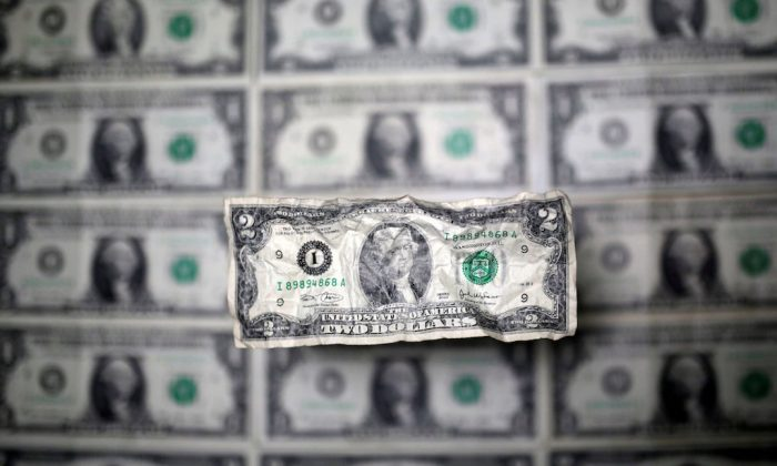 U.S. dollar banknote is seen in this picture illustration taken May 3, 2018. (REUTERS/Dado Ruvic/Illustration)
