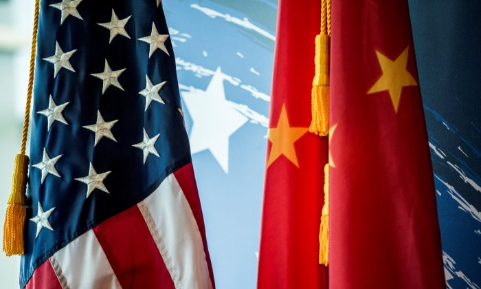 The U.S. and Chinese flags are seen during a promotional event in Beijing on June 30, 2017. (Fred Dufour/AFP/Getty Images)
