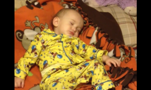 Baby's completely sound asleep. But when this starts playing, he immediately bolts up & dances