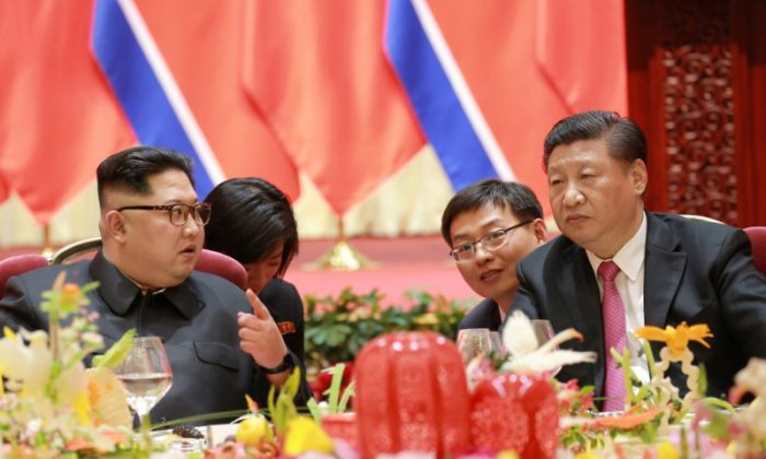 North Korean leader Kim Jong Un meets with Chinese leader Xi Jinping, in Dalian City in northeastern China in this undated photo released on May 9, 2018 by North Korea's Korean Central News Agency (KCNA). (KCNA/via Reuters)