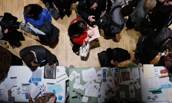 Job seekers speak to representatives of employers at a job fair in New York City in March, 2013. (Spencer Platt/Getty Images)