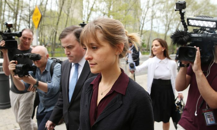 Actress Allison Mack (C) departs the United States Eastern District Court after a bail hearing in relation to the sex trafficking charges filed against her on May 4, 2018 in the Brooklyn borough of New York City. (Jemal Countess/Getty Images)
