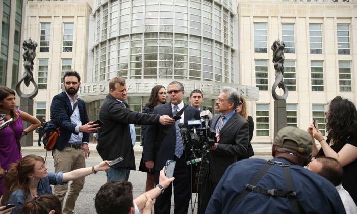 Lawyers Marc Agnifilo and Paul DerOhannesian speak to the media after a bail hearing for actress Allison Mack and NXIVM founder Keith Raniere, in relation to sex trafficking charges, in New York on May 4. (Jemal Countess/Getty Images)