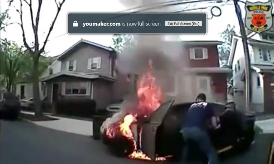 Police Bodycam Captures Rescue of Man From Burning Car