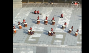 I hear the drums and it sounds amazing, but when the camera zooms in—I wouldn't have guessed