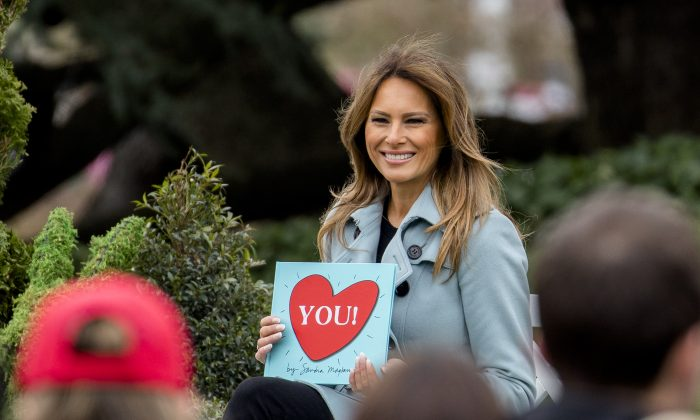 First Lady Melania Trump reads a children's book at the annual Easter Egg Roll on the South Lawn of the White House on April 2, 2018. (Samira Bouaou/The Epoch Times)