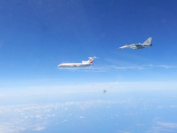 Taiwanese Air Force F-CK-1 fighter jet flies alongside a Chinese People's Liberation Army Air Force (PLAAF) Tu-154 electronic surveillance aircraft on May 11, 2018, in the western Pacific. (Photo released by Taiwan ROC Air Force )