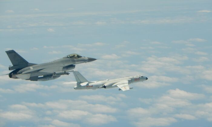 Taiwanese Air Force F-16 fighter jet flies alongside a Chinese People's Liberation Army Air Force (PLAAF) H-6K bomber in the western Pacific, one of the Chinese military aircraft that reportedly flew over Bashi Channel and Miyako Strait near Japan's Okinawa island chain on the morning of May 11, 2018. (Photo released by Taiwan ROC Air Force)