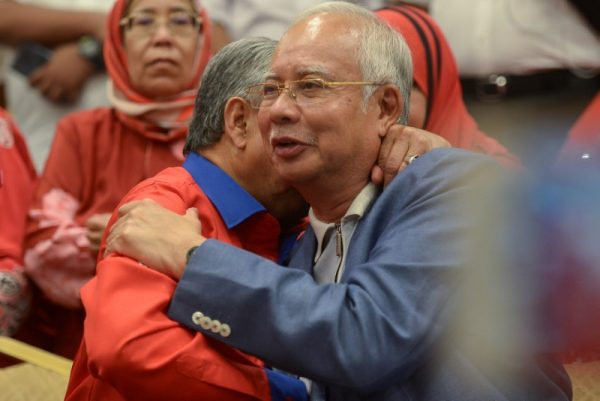 Former PM Najib, wife banned from leaving Malaysia