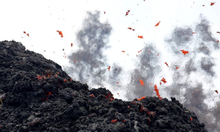 Lava erupts from a fissure east of the Leilani Estates subdivision during ongoing eruptions of the Kilauea Volcano in Hawaii, U.S., May 12, 2018. (Reuters/Terray Sylvester)
