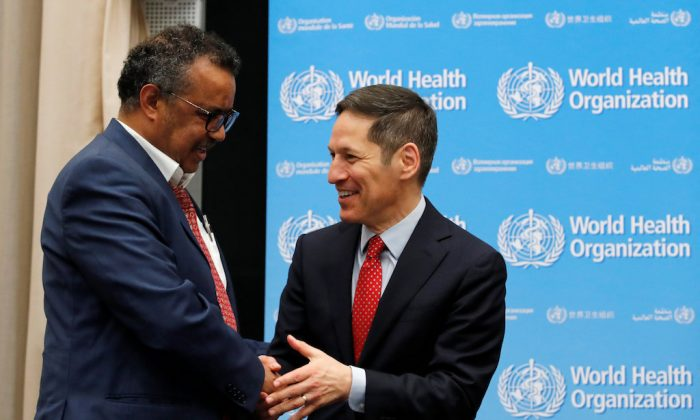 Director-General of the World Health Organization (WHO) Tedros Adhanom Ghebreyesus (L) arrives with Thomas Frieden, President and CEO Resolve to Save Lives for a news conference at the WHO's headquarters in Geneva, Switzerland on May 14, 2018.  (REUTERS/Denis Balibouse)