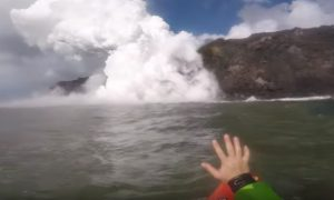 Kayakers come across a huge lava waterfall in Hawaii. The footage they get—it's breathtaking