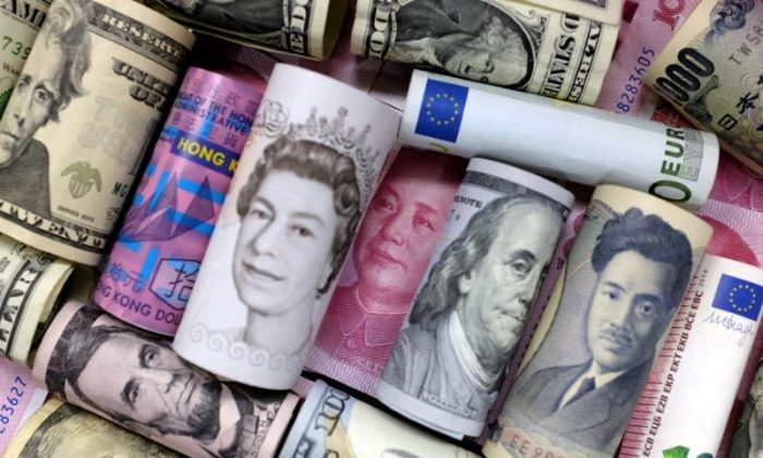 Euro, Hong Kong dollar, U.S. dollar, Japanese yen, pound and Chinese 100 yuan banknotes are seen in this picture illustration, Jan. 21, 2016.   (REUTERS/Jason Lee/Illustration/File Photo)