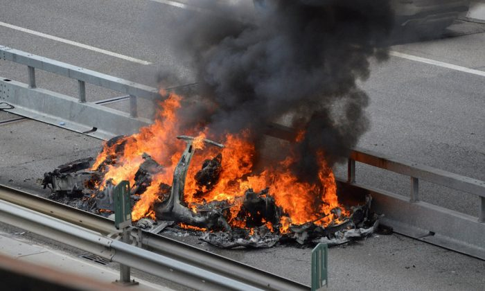 An electric-powered Tesla car burns after a crash on the Swiss A2 motorway on Monte Ceneri near Bellinzona, Switzerland May 10, 2018. Picture taken on May 10, 2018.     (REUTERS/Rescue Media)