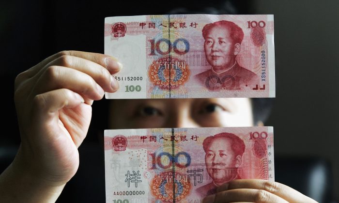 This undated photo shows 100 yuan notes at a bank in Shanghai, China. (China Photos/Getty Images)