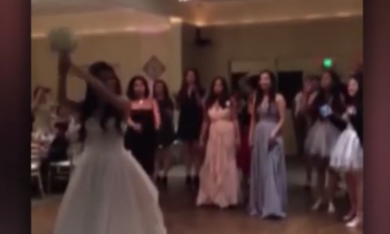 Bride's sister huddled with others to catch the bouquet—but she has no idea what's about to hit her
