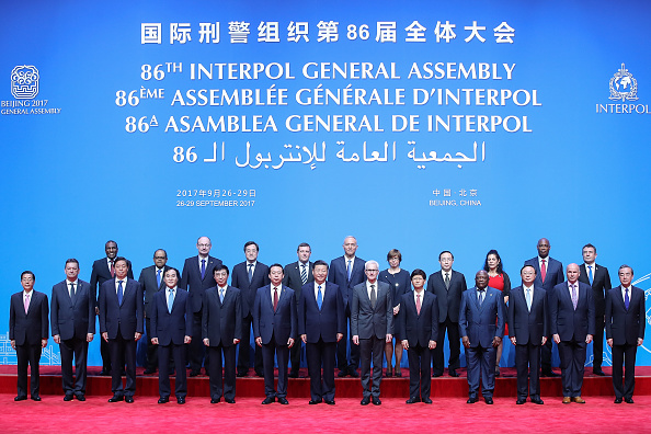 Chinese President Xi Jinping (C) with Secretary General Interpol Jurgen Stock (Center-R) and Meng Hongwei (Center-L), president of Interpol pose for a group photo before the 86th INTERPOL General Assembly at Beijing National Convention Center on September 26, 2017 in Beijing, China. (Lintao Zhang - Pool/Getty Images)