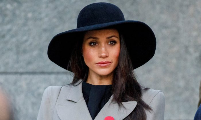 Meghan Markle, the fiancee of Britain's Prince Harry, attends the Dawn Service at Wellington Arch to commemorate Anzac Day in London, Britain, April 25, 2018. (Tolga Akmen/Pool via Reuters)