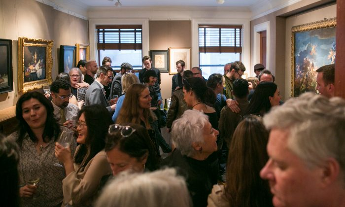 """A packed crowd of visitors at the opening of """"The Unbroken Line: Old and New Masters"""" at the Robert Simon Fine Art gallery in Upper East Side, New York, on May 10, 2018. (Milene Fernandez/The Epoch Times)"""