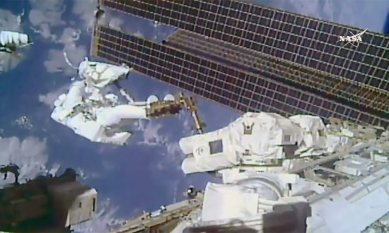 NASA Astronauts Perform Maintenance Duties Outside Space Station