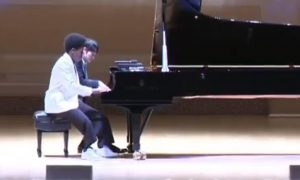 Four-Fingered, Self-Taught Pianist Produces First Song