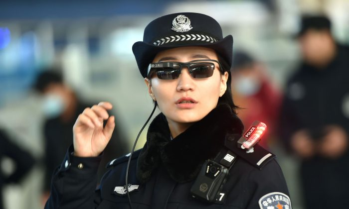 A police officer wearing a pair of smart glasses fitted with a facial recognition system at the Zhengzhou East Railway Station in Zhengzhou City, in China's central Henan Province on February 5, 2018. (AFP/Getty Images)